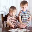 Boys are mixing mincemeat in a bowl — Stock Photo