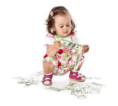 A little girl with money — Stock Photo