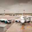 Airliner parked at the airport - Stock Photo