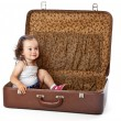 A girl is sitting in a suitcase. — Stock Photo