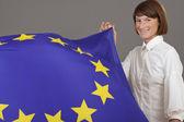 Happy woman holding european flag — Stock Photo