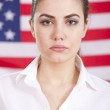 Portrait of woman over american flag — Stock Photo #9463488