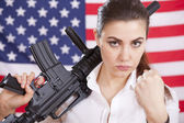 Woman with machine gun threatening — Stock Photo