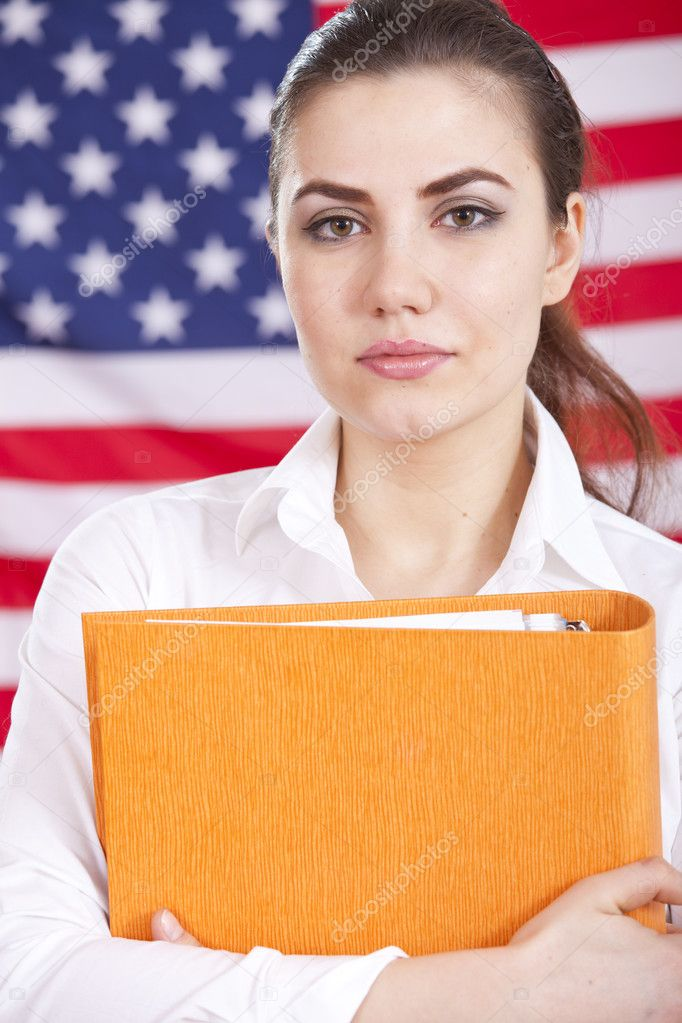 Portrait of female student holding a folder over american flag — Stock Photo #9463429