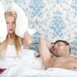 Royalty-Free Stock Photo: Snoring man and frustrated woman