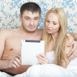 Couple with tablet computer — Stock Photo