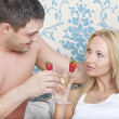 Couple drinking in bed — Stock Photo #9999696