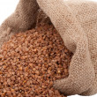 Stock Photo: Burlap sack with buckwheat spilling