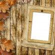 Autumn frame of oak leaves on a grange background. — Stock Photo #8011932