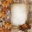 Autumn frame of oak leaves on a grange background. — Stock Photo #8022478
