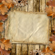 Autumn frame of oak leaves on a grange wooden background. — Stock Photo #8022509