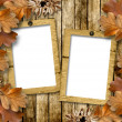 Autumn frame of oak leaves on a grange wooden background. — Stock Photo #8022523