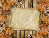 Autumn frame of oak leaves on a grange wooden background. — Stockfoto