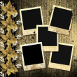 Old photoframes are hanging on the vintage background. - Stock Photo