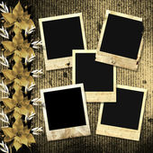 Old photoframes are hanging on the vintage background. — Stock Photo