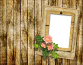 Framework for photo on the wooden background — Stock Photo