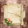Vintage papper med en rosor på vintage bakgrunden — Stockfoto