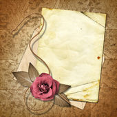 Old paper with a rose on the vintage background. — Stock Photo