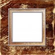 Stock Photo: Gold frame with a decorative pattern on the abstract background.