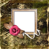Vintage gold frame with a rose. Framework for a photo or congrat — Stock Photo