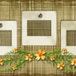 Old photoframes are hanging on the vintage background. — Stockfoto