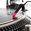 Turntable playing vinyl with music — Stock Photo #8893434