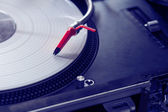 Professional turntable playing vinyl record — Stock Photo