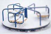 Carousel playground in snow — Stock Photo