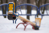 Seesaw playground in snow — Stock Photo