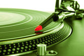 Turntable playing vinyl record — Stock Photo