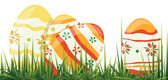 Easter eggs in grass — Stock Vector