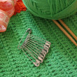 Green clew and needle for knitting — Stock Photo