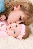 Portrait of happy mother with little baby girl — Stock Photo