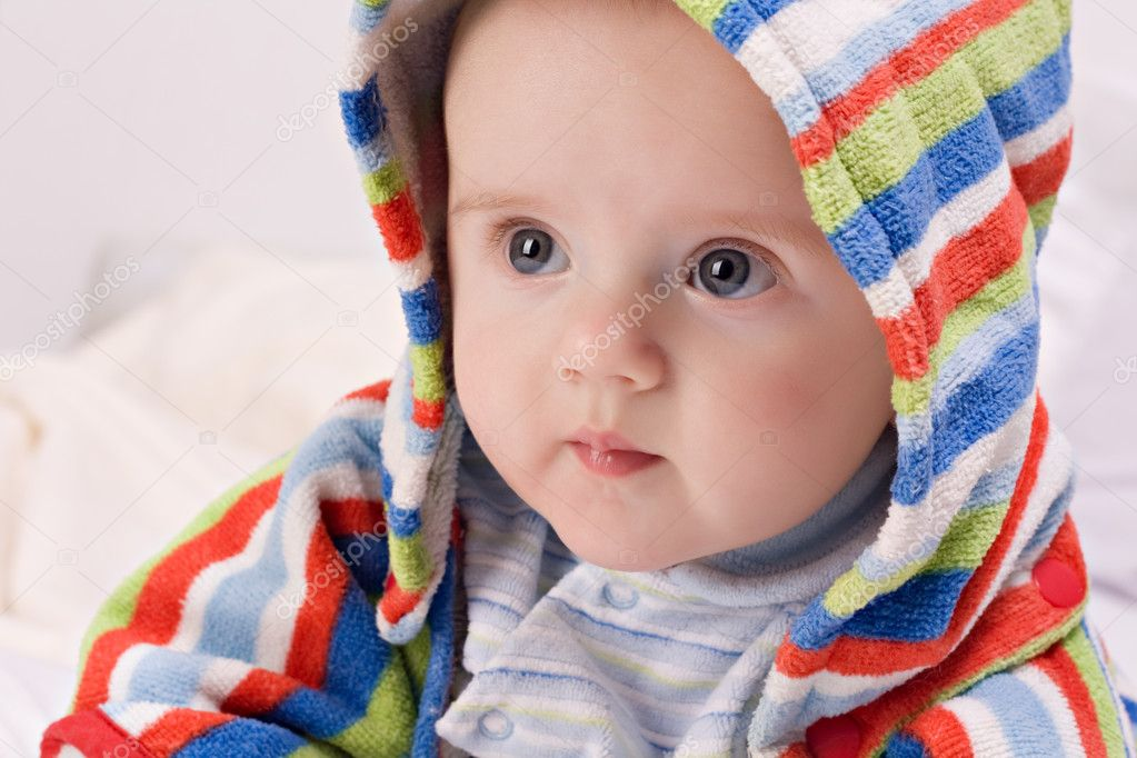 Charming baby boy in bathrobe with a hood — Stock Photo #9512811
