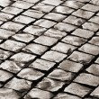 Old medieval granite cobble road - Stock Photo
