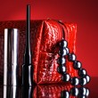Red bag for makeup and lipstick and mascara. - Стоковая фотография