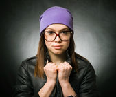 Girl in a purple knitted hat and sunglasses — Stock Photo