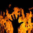 Man's hand against the fire. gesture of support — Stock Photo