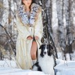 Woman with wolfhound outdoors — Stok fotoğraf