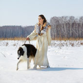 Woman with borzoi outdoors — Stock Photo