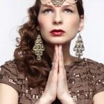 Beautiful brunette in jewellery — Stock Photo #10206827