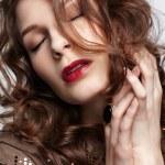 Beautiful brunette in jewellery — Stock Photo #10206885