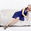 Stock Photo: Womrelaxing on sofa