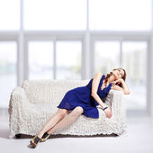 Brunette relaxing on sofa — Stock Photo