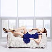 Brunette relaxing on sofa — Stock Photo