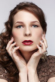 Beautiful brunette in jewellery — Stock Photo