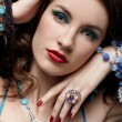 Beautiful woman in jewelry — Stockfoto