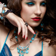beautiful woman in jewelry — Stock Photo