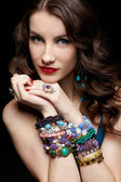 Beautiful woman in jewelry — Stok fotoğraf