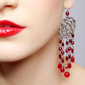 Beautiful woman in ear-rings — Stock Photo